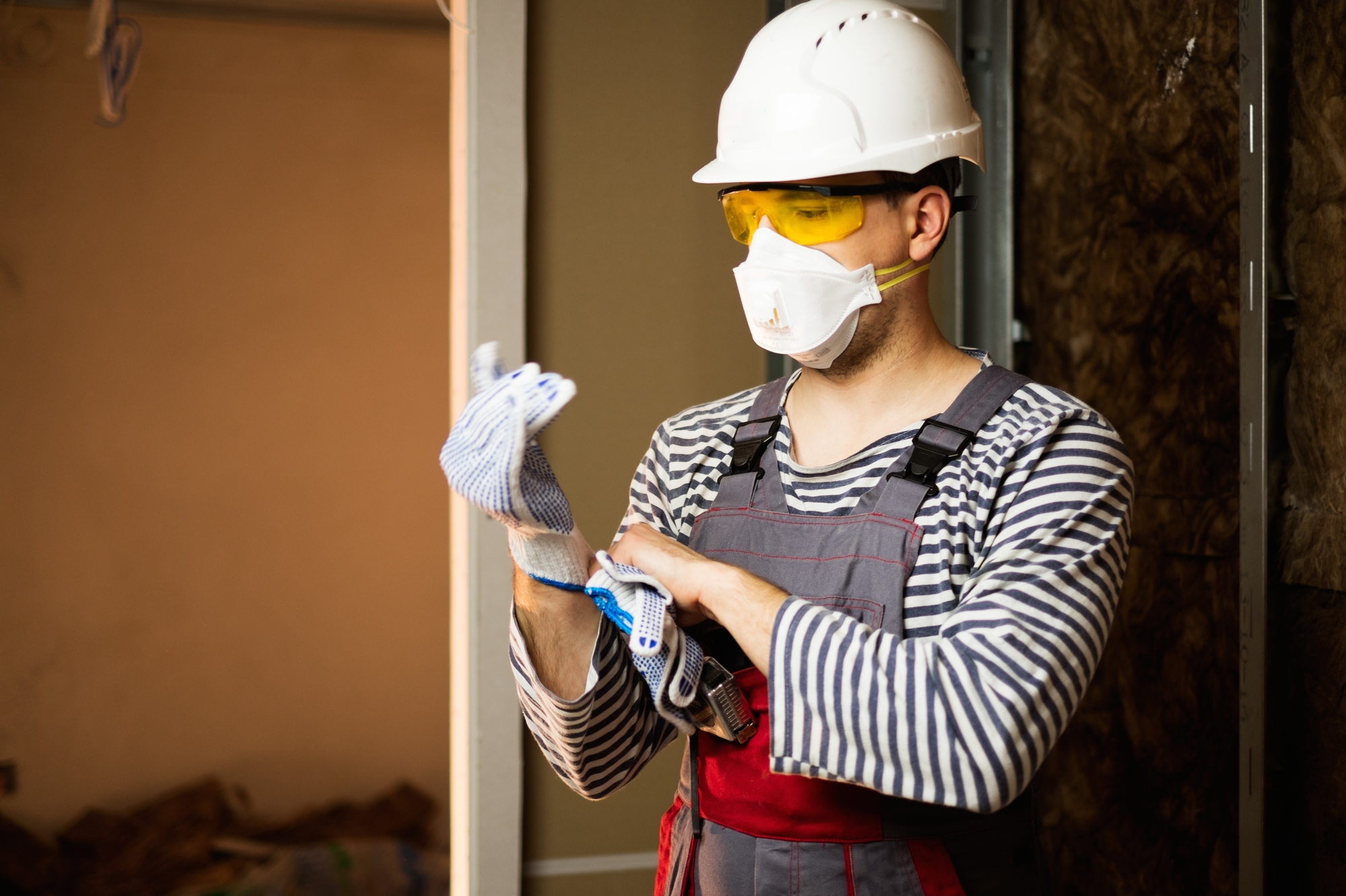 Builder in protective wear