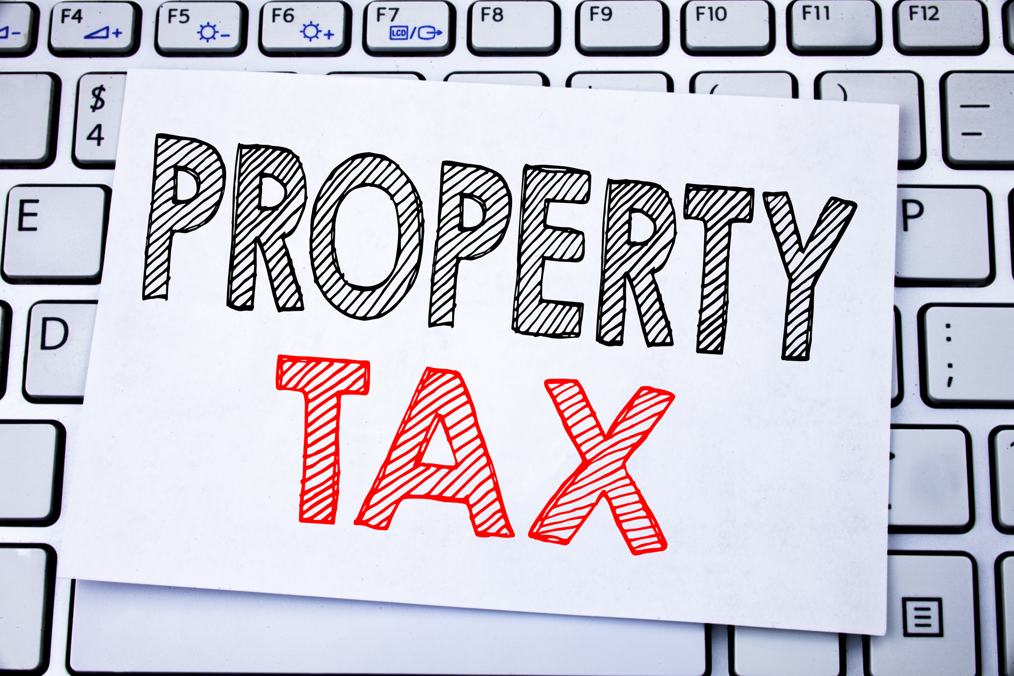 Business concept writing for Estate Income Taxation written on sticky note paper on the white keyboard background