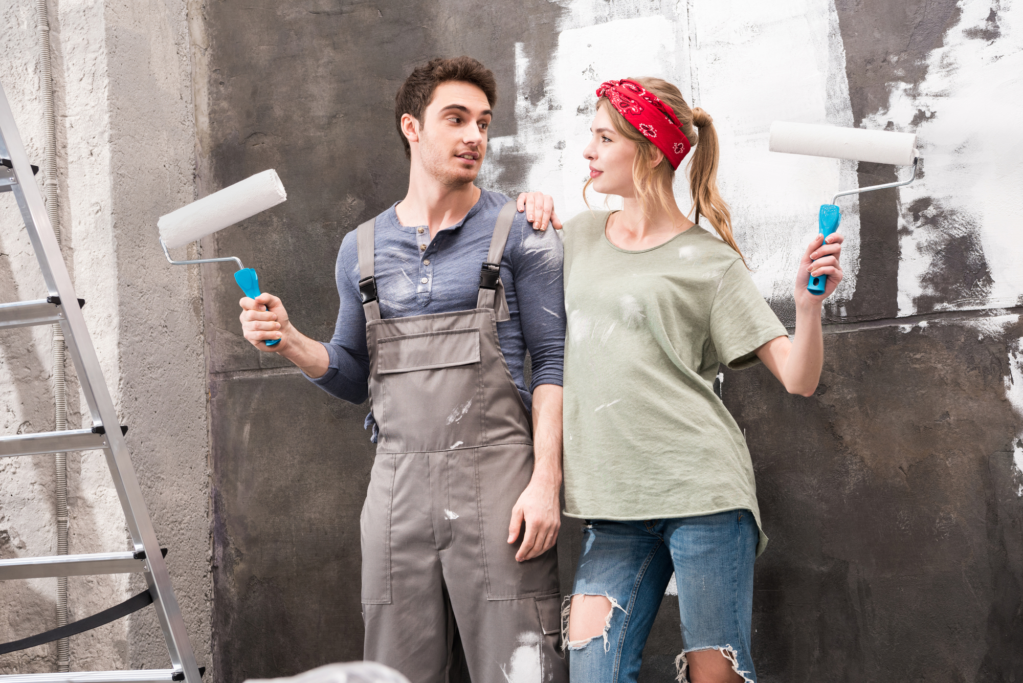 Couple with paint rollers