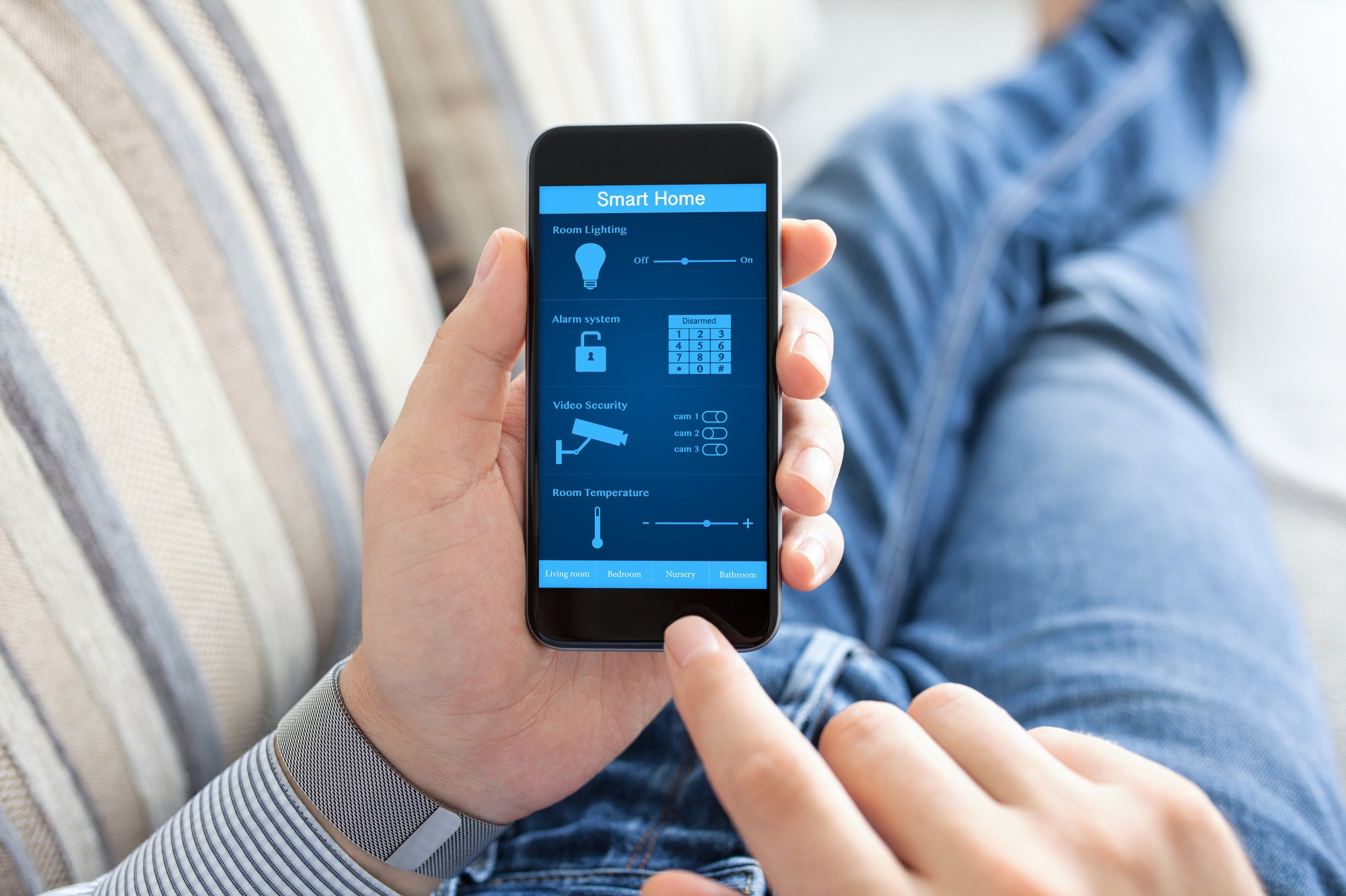 Man holding phone with smart home on screen