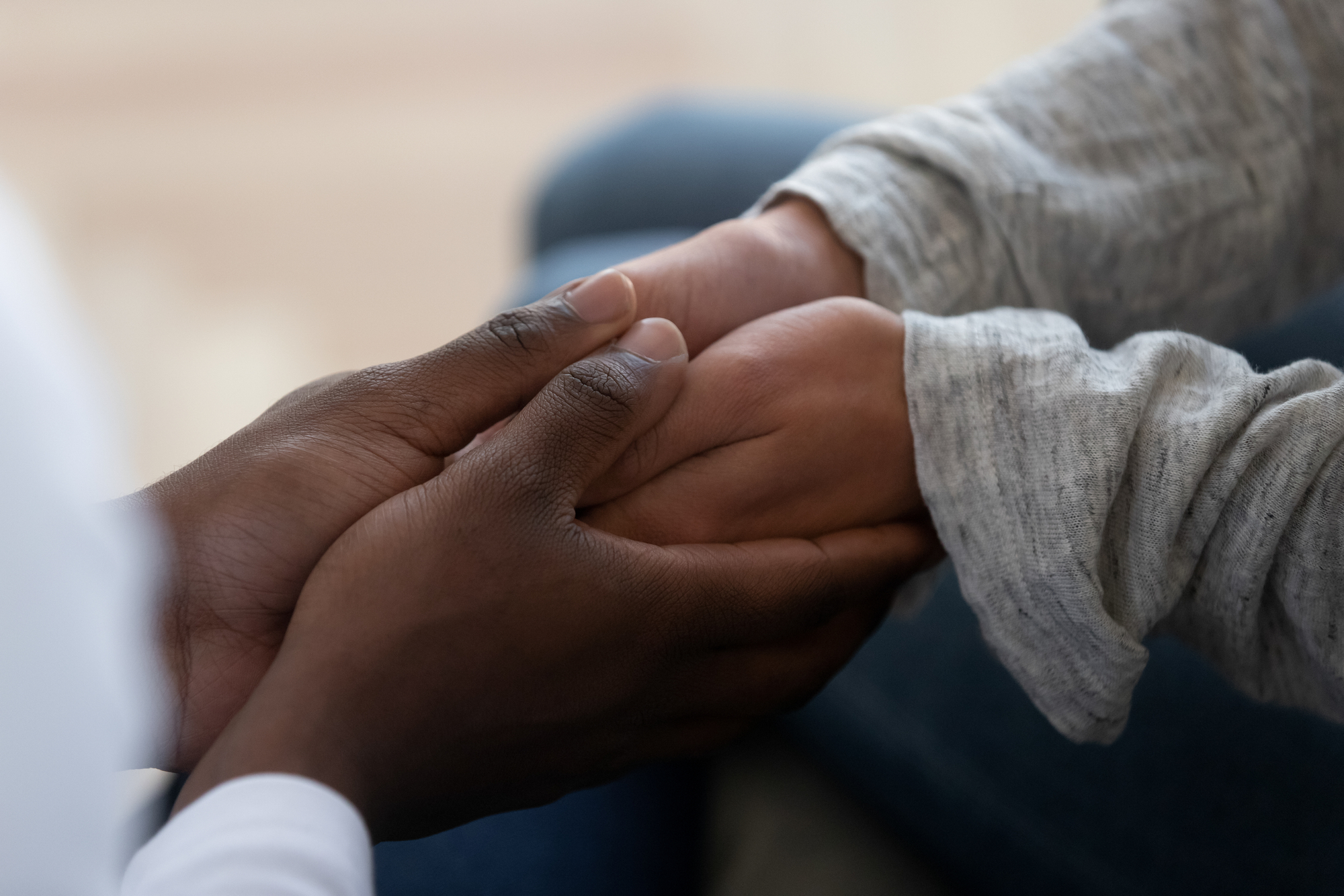 Mixed ethnicity family couple holding hands express support in marriage