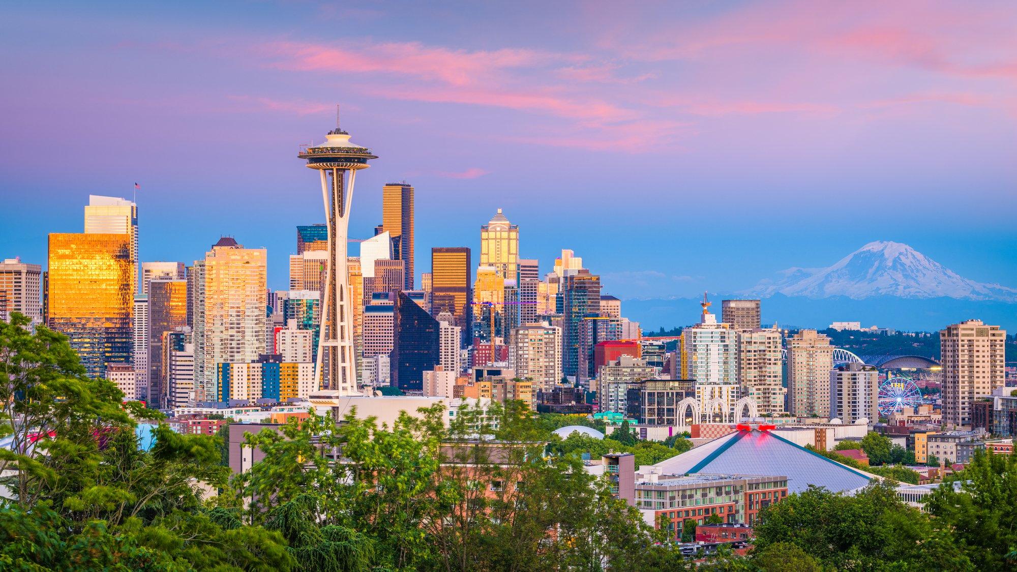 Seattle, Washington, USA downtown skyline at night with Mt. Rainier