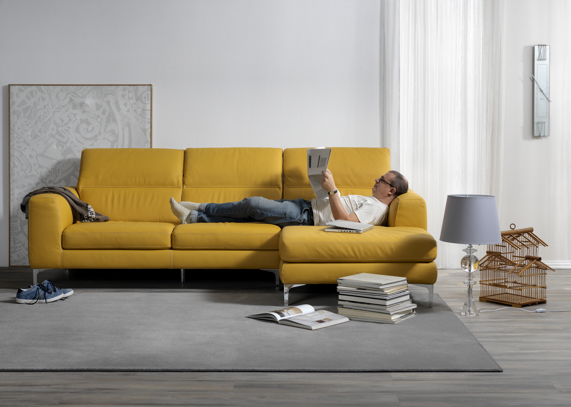 Single shot photo of a room with a sofa and person